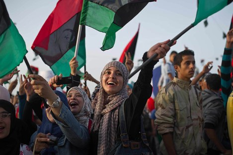 Libyans celebrate following the official declaration of liberation