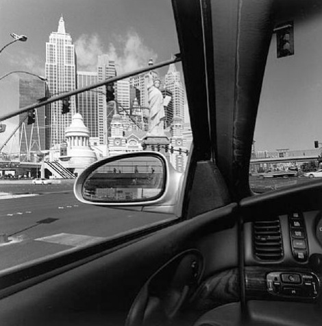 Picture of a city skyline by Lee Friedlander from inside his car