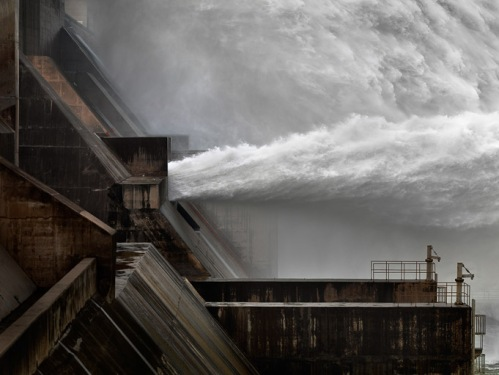 Photograph of water bursting out a dam in China